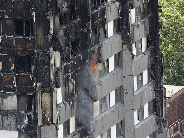 Grenfell Tower in west London is seen on Thursday, after a fire engulfed the 24-story building in the early hours of Wednesday.