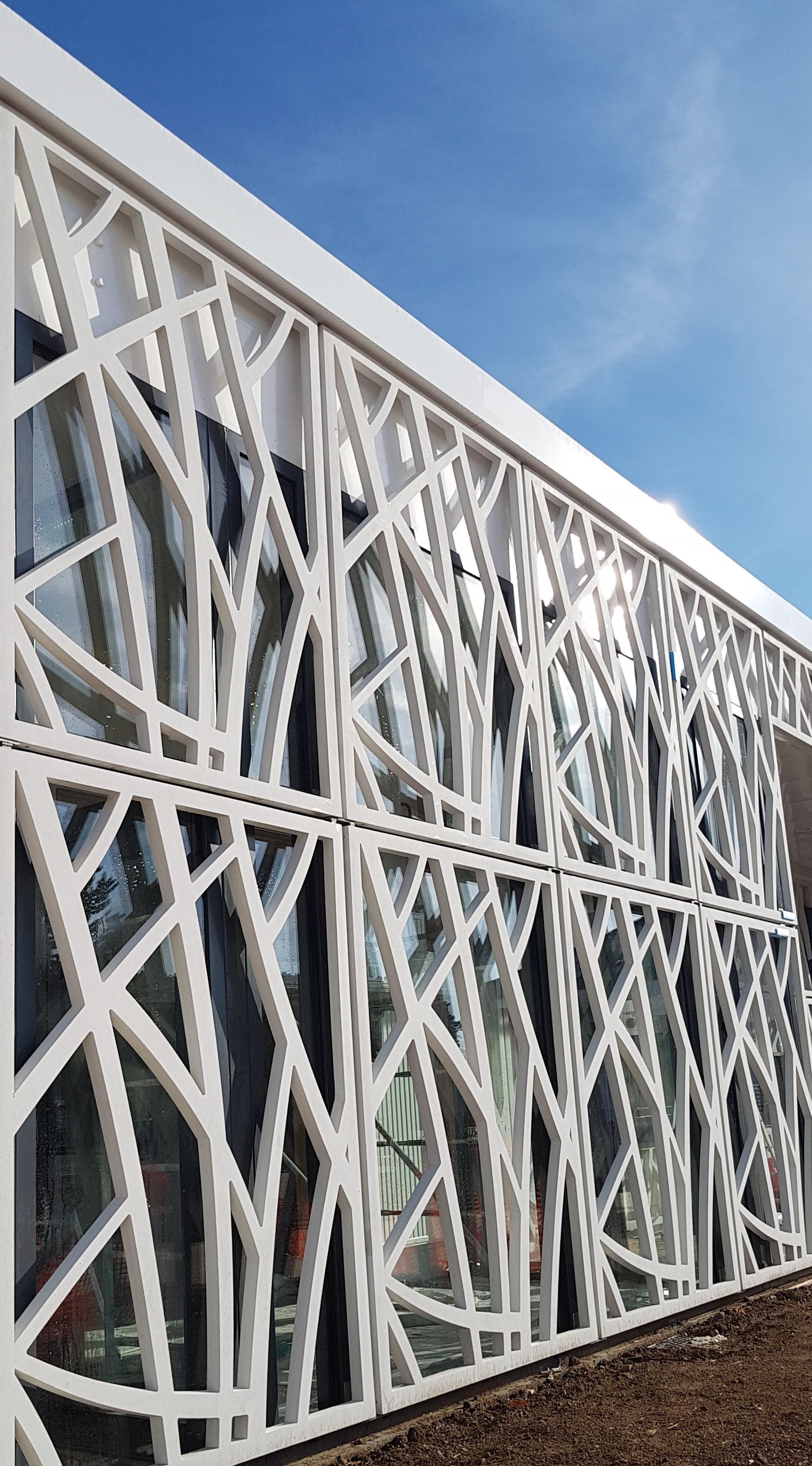 Perforated facade anchoring